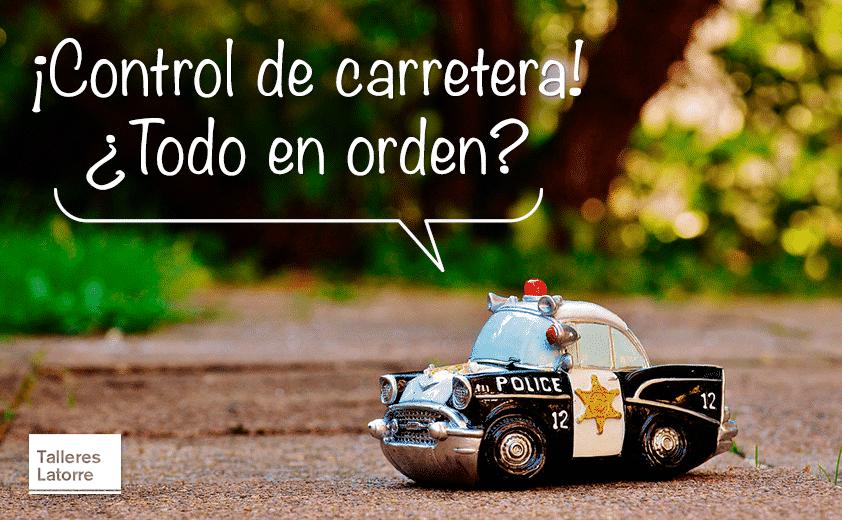 """Un cochecito de juguete con la leyenda """"Control de carretera, ¿todo en orden?. Vigilancia intensiva de la DGT."""